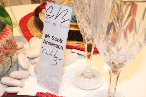 "L Shape Photo Strip Frames 2x6"" Displayed On Wedding Table"