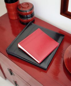 Red and Black Leather Photo Albums on Table