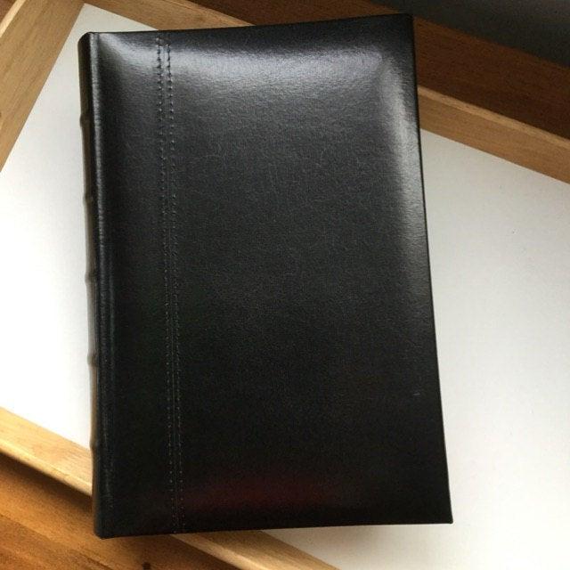 Black Leather 300 Album On Desk